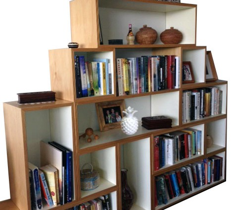 a book shelving system that adds modules